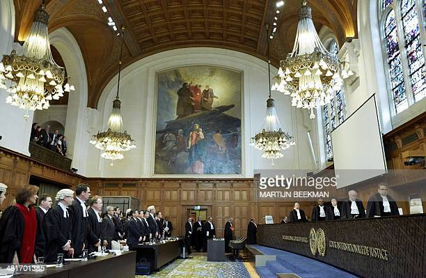 Judges enter the courtroom prior to the verdict in the case against Japanese whaling at the International Court of Justice in The Hague the...