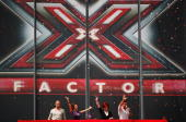 Judges for the new X Factor series 4 Brian Friedman Dannii Minogue Sharon Osbourne and Simon Cowell wave to the crowd during the first day of...