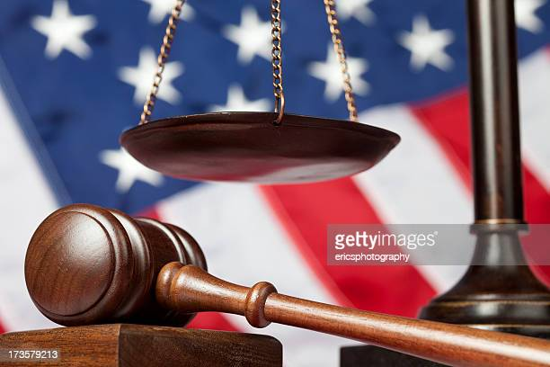 Judge's gavel next to scale of justice
