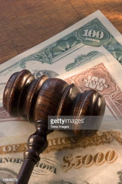 Judge's gavel on bank notes