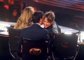 Judges Jennifer Lopez Harry Connick Jr and Keith Urban onstage at FOX's 'American Idol XIII' Top 4 To 3 Live Elimination Show on May 7 2014 in...