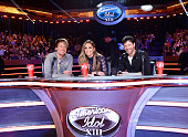 Judges Keith Urban Jennifer Lopez and Harry Connick Jr are seen on FOX's 'American Idol' Season 13 Top 13 Perform Live Show on February 26 2014 in...