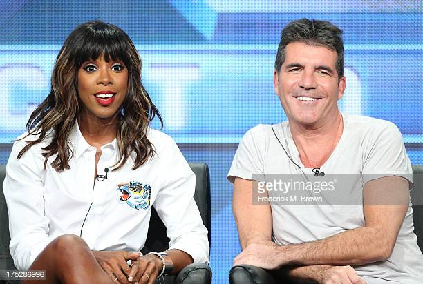 "Judges Kelly Rowland and Simon Cowell speak onstage during the ""The X Factor"" panel discussion at the FOX portion of the 2013 Summer Television..."