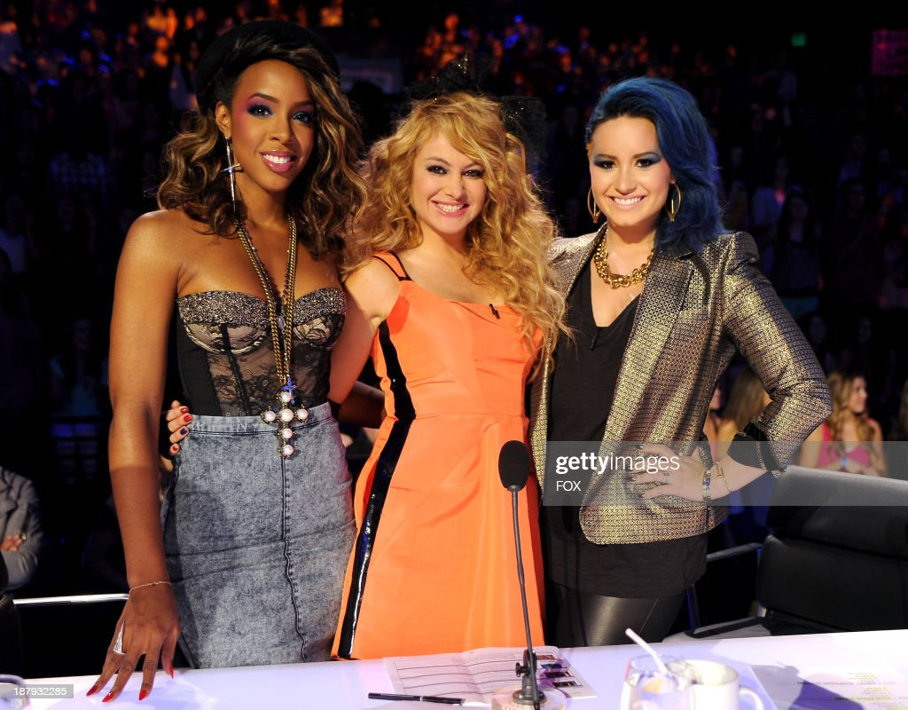 Judges Kelly Rowland Paulina Rubio and Demi Lovato on FOX's 'The X Factor' Season 3 Top 13 To 12 And Top 12 Perform Live on 80's night on November 13...