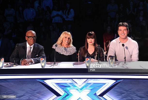 Judges LA Reid Britney Spears Demi Lovato and Simon Cowell onstage at FOX's 'The X Factor' Season 2 Live Performance Show on October 31 2012 in...