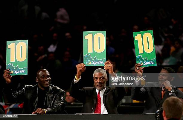Judges Michael Jordan Julius Erving and Dominique Wilkins hold up the scores for the winning dunk by Gerald Green of the Boston Celtics in the Sprite...