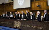 Judges of the International Court of Justice arrive in the courtroom during the first day of the witnesses in the Croatia vs Serbia case in the Peace...