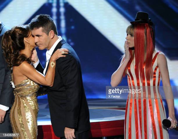 Judges Paula Abdul Simon Cowell and contestant Drew Ryniewicz onstage at FOX's 'The X Factor' Top 9 to 7 Live Elimination Show on November 23 2011 in...