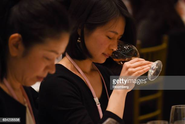 A judges smells a glass of wine at the 4th Sakura Japan Women's Wine Awards 2017 the international wine competition judged by female wine...