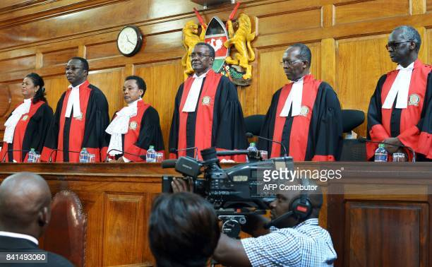 Judges stand to deliver their verdict at the Supreme Court in Nairobi on September 1 ordering a new presidential election within 60 days after...