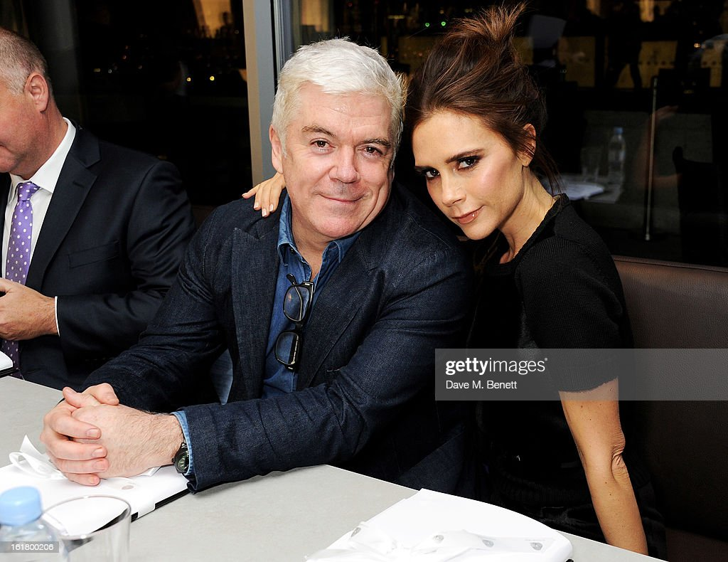 Judges Tim Banks (L) and Victoria Beckham attend the 2013 International Woolmark Prize Final at ME London on February 16, 2013 in London, England.