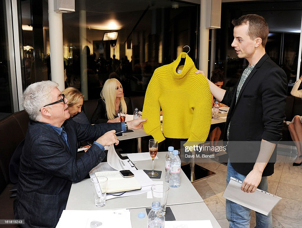 (L to R) Judges Tim Blanks, Carla Sozzani and Donatella Versace listen to a presentation by European finalist Christian Wijnats attend the 2013 International Woolmark Prize Final at ME London on February 16, 2013 in London, England.