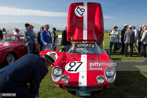 Judges view a 1964 Ferrari SpA 250LM Scaglietti Berlinetta vehicle during the 2015 Pebble Beach Concours d'Elegance in Pebble Beach California US on...