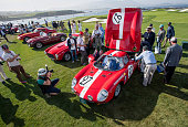 Judges view a 1964 Ferrari SpA 250LM Scaglietti Berlinetta vehicle during the 2015 Pebble Beach Concours d'Elegance in Pebble Beach California US on...