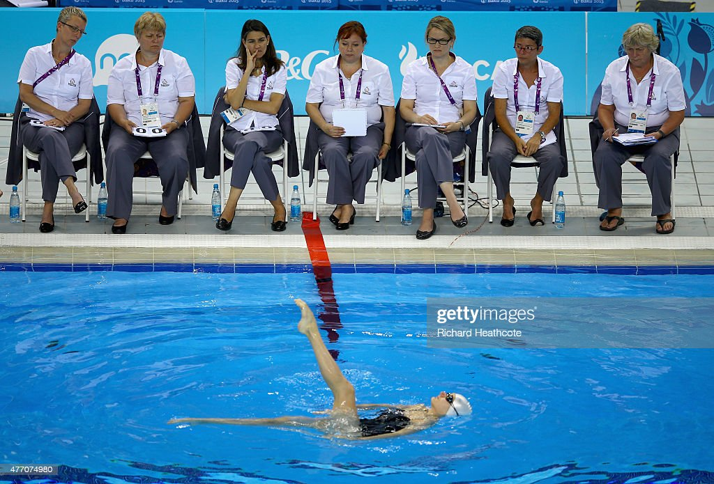 Judges watch an athlete perform in the Figures Synchronised Swimming during day two of the Baku 2015 European Games at Baku Aquatics Centre on June 14, 2015 in Baku, Azerbaijan.