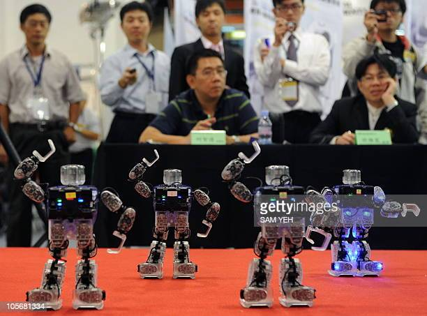 Judges watch robots dance during the Taipei International Robot Show at the World Trade Center on October 19 2010 Some 300 exhibitors from 66...