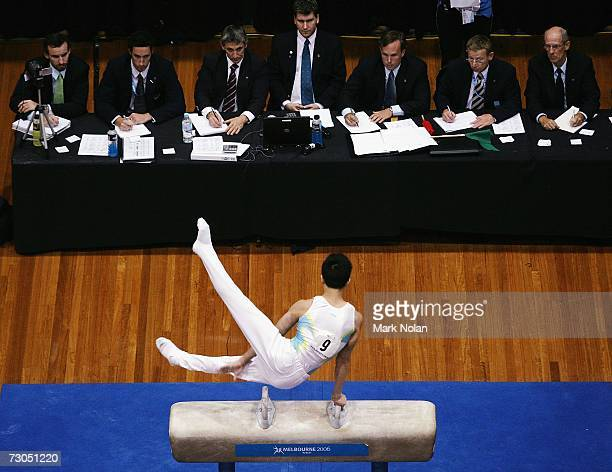 Judges watch Xuezhang Chen of China complete his pommer horse routine during the artistic Gymnastics competition of the Australian Youth Olympic...