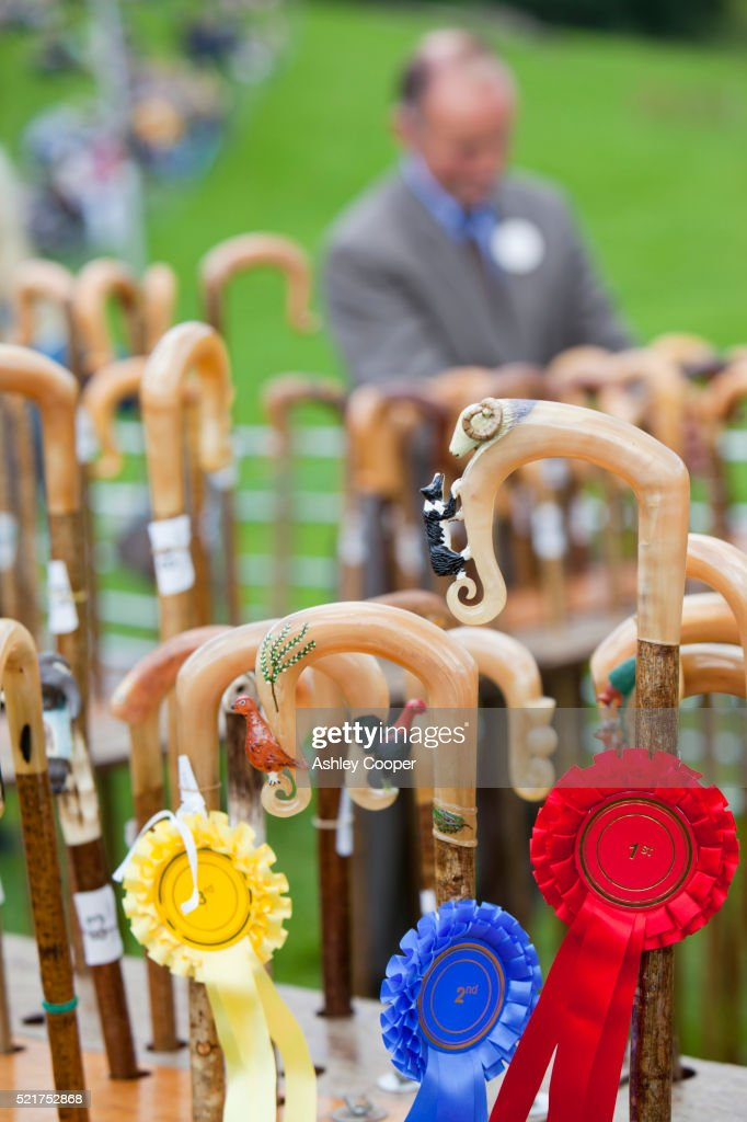 Judging the shepherds crooks at the Vale of Rydal Sheepdog Trials, Ambleside, Lake District, UK.