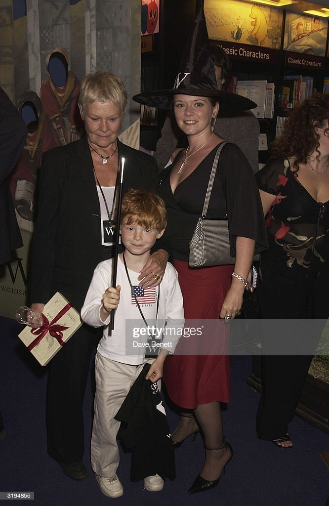 Judi Dench, daughter Finty Williams and grandson Samuel attend the Waterstones Harry Potter Party at the Piccadilly Store on June 21, 2003 in London.