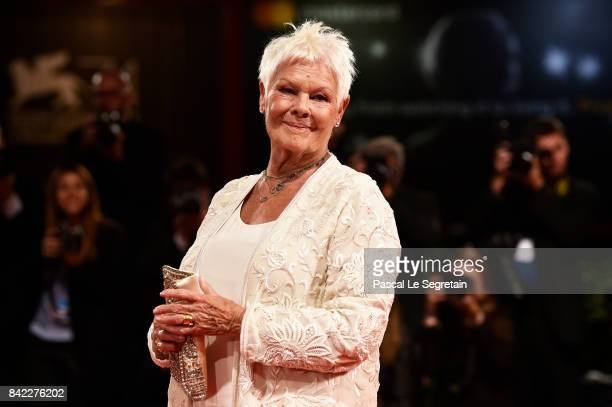 Judi Dench walks the red carpet ahead of the 'Victoria Abdul' screening and JaegerLeCoultre Glory To The Filmaker Award 2017 during the 74th Venice...