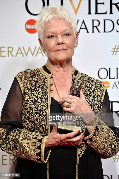 Judi Dench winner of the award for Best Actress in a Supporting Role for ' The Winter's Tale' poses in the winners room at The Olivier Awards at The...