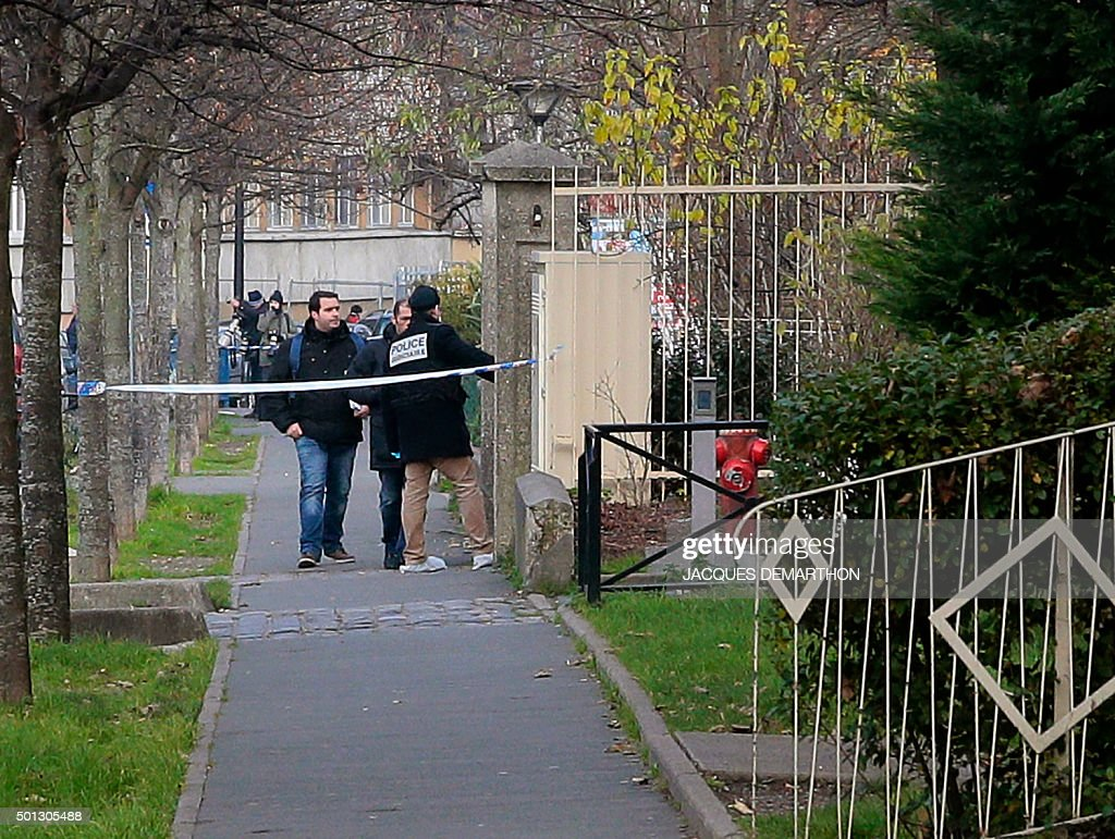 Judicial police are seen outside JeanPerrin nursery school in Aubervilliers a suburb northeast of Paris where a teacher was attacked in the morning...