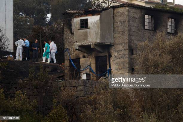 Judicial police works at a burnt house in the village of Vila Nova near Vouzela on October 17 2017 in Viseu region Portugal At least 41 people have...