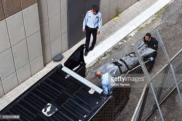 Judicial staff members take out the body of a teacher allegedly killed by a student armed with a crossbow at the Instituto Joan Foster on April 20...