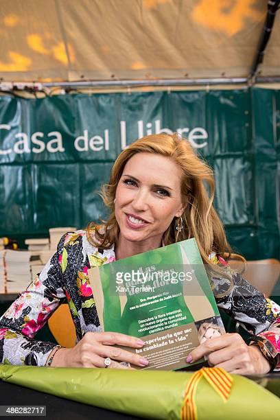 Judit Masco signs books at Sant Jordi's day on April 23 2014 in Barcelona Spain