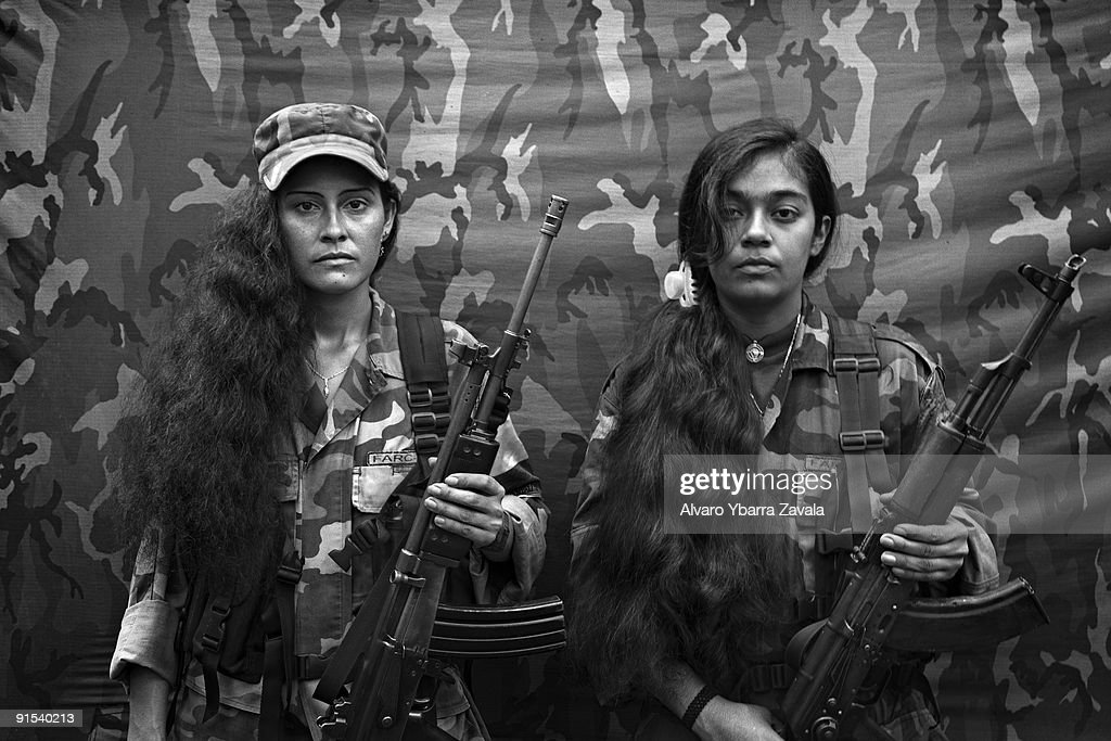 Judith and Isa, two female FARC guerrillas from the bloque movil Arturo Ruiz, inside one of the FARC camps. The Bloque Movil Arturo Ruiz of the revolutionary armed forces of Colombia (FARC) are a special unit of FARC who fight in many different regions of Colombia. This unit is like a quick reaction force who help other sub-groups of FARC. They are allegedly responsible for hostage-taking.
