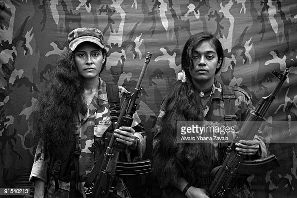 Judith and Isa two female FARC guerrillas from the bloque movil Arturo Ruiz inside one of the FARC camps The Bloque Movil Arturo Ruiz of the...