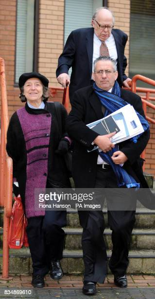 Judith Arnold her husband Michael Arnold top right depart West London Magistrates Court with their lawyer Laurence Lee bottom right where they...