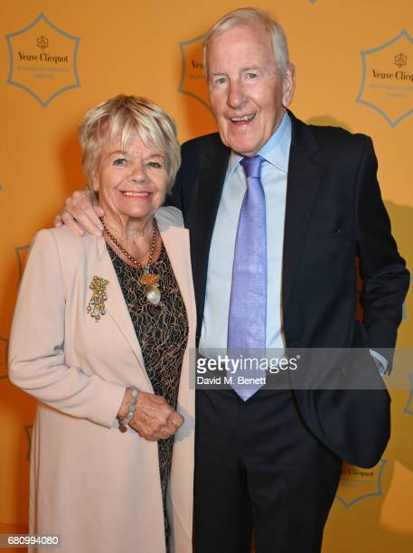 Judith Chalmers and Neil DurdenSmith attend the Veuve Clicquot Business Woman Awards at Claridge's Hotel on May 9 2017 in London England