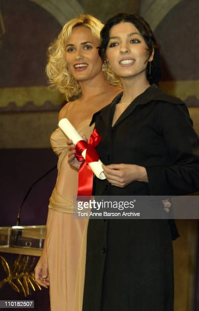 Judith Godreche and Samira Makhmalbaf during 2003 Cannes Film Festival Closing Ceremony Show at Palais des Festivals in Cannes France