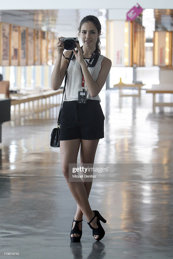 Judith Martinez student and blogger wears a Zara shirt, Mango short, Jeffery Campbell shoes, vintage bag and Leica camera at the 080 Barcelona Fashion Week Spring/Summer 2014 on July 11, 2013 in Barcelona, Spain.