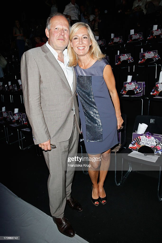 Judith Milberg and Axel Milberg attend the Laurel Show during the Mercedes-Benz Fashion Week Spring/Summer 2014 at Brandenburg Gate on July 4, 2013 in Berlin, Germany.