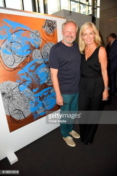 Judith Milberg and her husband Axel Milberg in front of one of her paintings during her exhibition opening 'Judith Milberg Aus der Mitte' at...