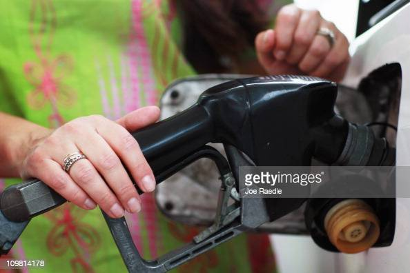Judith Monsalve pumps gas at the Ugas station March 6 2011 in Miami Florida The national average for a gallon of selfserve regular gas was $350 a 33...