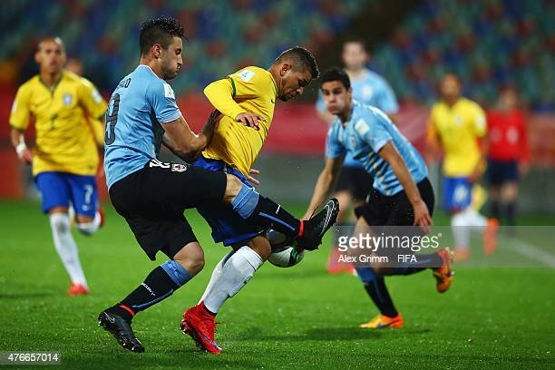 Judivan 8r9 of Brazil is challenged by Erick Cabaco of Uruguay during the FIFA U20 World Cup New Zealand 2015 Round of 16 match between Brazil and...