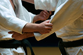 Judo fighters sparring off in a battle of body and mind