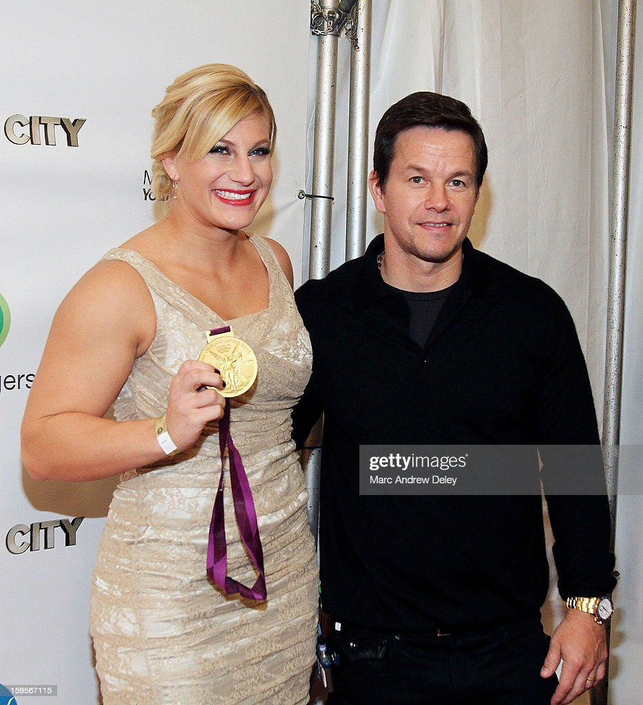 Judo Olympic Gold Medalist <a gi-track='captionPersonalityLinkClicked' href=/galleries/search?phrase=Kayla+Harrison&family=editorial&specificpeople=7179048 ng-click='$event.stopPropagation()'>Kayla Harrison</a> and <a gi-track='captionPersonalityLinkClicked' href=/galleries/search?phrase=Mark+Wahlberg&family=editorial&specificpeople=202265 ng-click='$event.stopPropagation()'>Mark Wahlberg</a> before the screening of 'Broken City' hosted by <a gi-track='captionPersonalityLinkClicked' href=/galleries/search?phrase=Mark+Wahlberg&family=editorial&specificpeople=202265 ng-click='$event.stopPropagation()'>Mark Wahlberg</a> at Patriot Cinemas on January 15, 2013 in Hingham, Massachusetts.