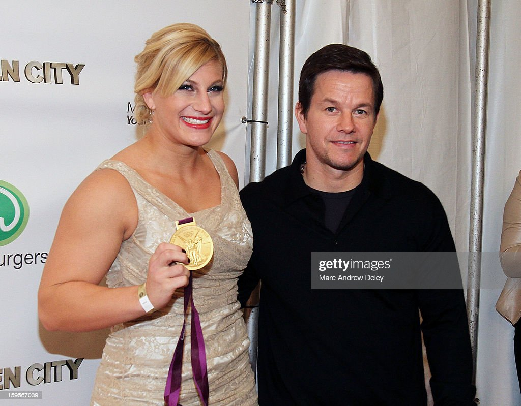 Judo Olympic Gold Medalist Kayla Harrison and Mark Wahlberg pose before the screening of 'Broken City' hosted by Mark Wahlberg at Patriot Cinemas on January 15, 2013 in Hingham, Massachusetts.