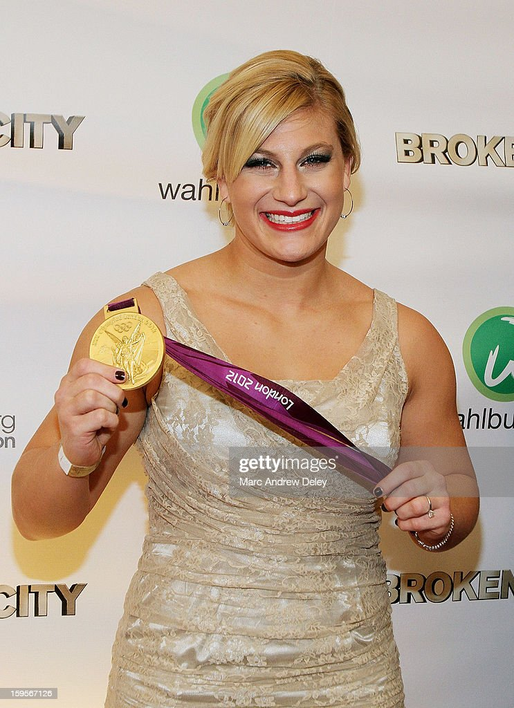 Judo Olympic Gold Medalist <a gi-track='captionPersonalityLinkClicked' href=/galleries/search?phrase=Kayla+Harrison&family=editorial&specificpeople=7179048 ng-click='$event.stopPropagation()'>Kayla Harrison</a> poses with her medal as she attends the screening of 'Broken City' hosted by Mark Wahlberg at Patriot Cinemas on January 15, 2013 in Hingham, Massachusetts.