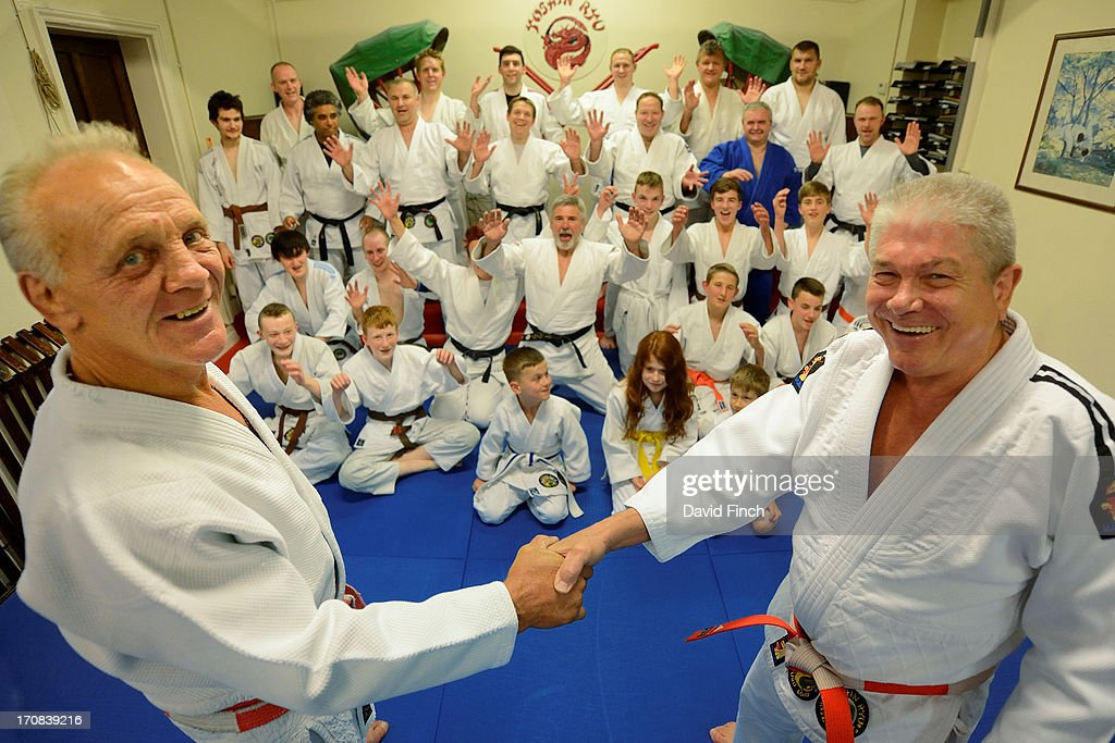 Judo Olympic medallist, European champion and legendary Superstar Champion, Brian Jacks (left), is congratulated by Errol Field, the club's founder, after coaching at the the Yoshin Ryu Judo Club, Coulsdon, Great Britain, on Monday, June 17, 2013.