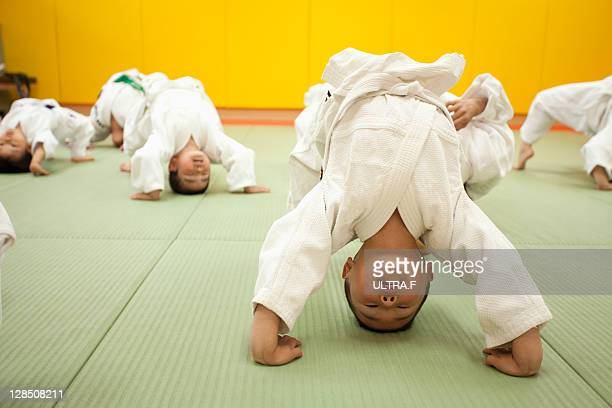 Judo player of the boy is limbering up.