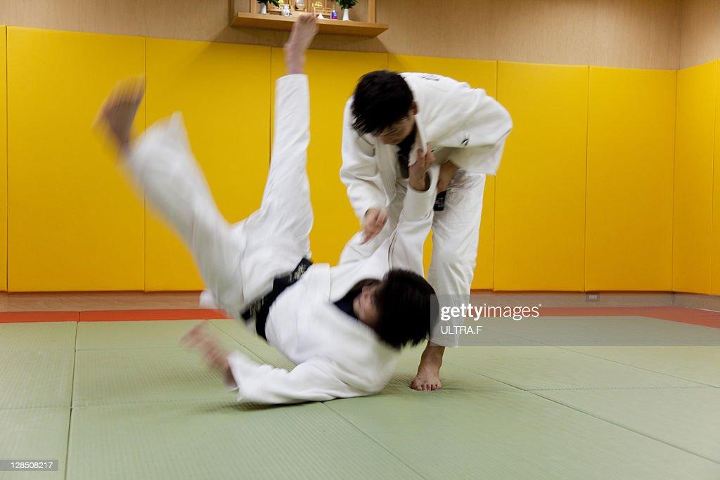 Judo players fighting : Stock Photo