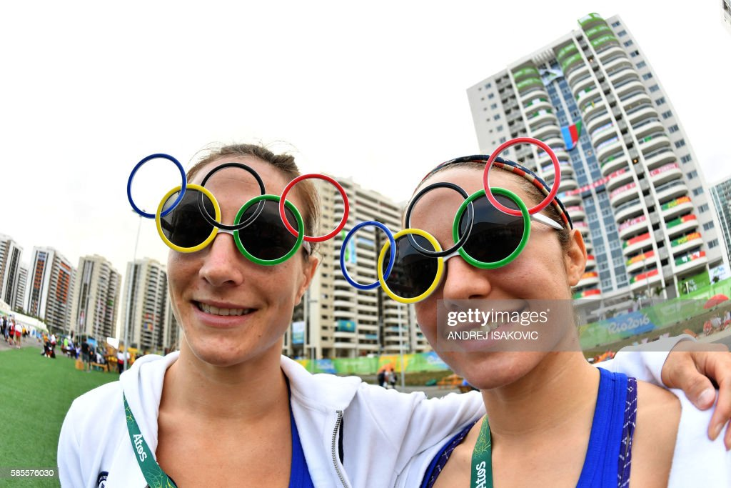 TOPSHOT US judoka Marti Malloy and Angelica Delgado pose for a picture at the Athletes' Village ahead of the Rio 2016 Olympic Games in Rio de Janeiro...
