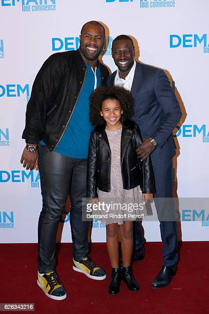 Judoka Teddy Riner actors of the movie Gloria Colston and Omar Sy attend the 'Demain Tout Commence' Paris Premiere at Cinema Le Grand Rex on November...