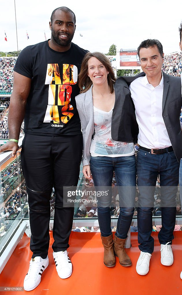 Judoka Teddy Riner, Former Tenis player Justine Henin and Sports journalist Laurent Luyat pose at France Television french chanel studio during the 2015 Roland Garros French Tennis Open - Day Six, on May 29, 2015 in Paris, France.