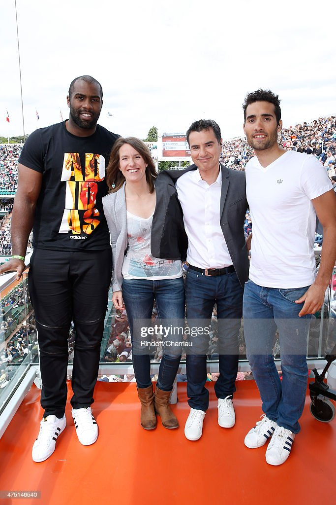 Judoka Teddy Riner, Former Tenis player Justine Henin, Sports journalist Laurent Luyat and Biathlete Martin Fourcade pose at France Television french chanel studio during the 2015 Roland Garros French Tennis Open - Day Six, on May 29, 2015 in Paris, France.